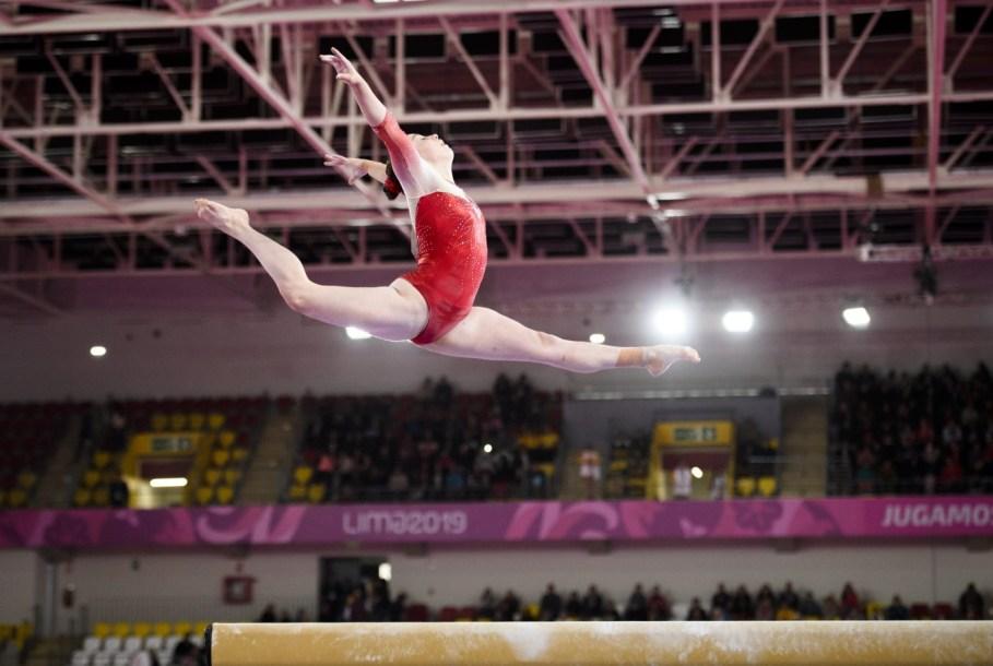 Isabela Onyshko of Canada competes in the balance beam