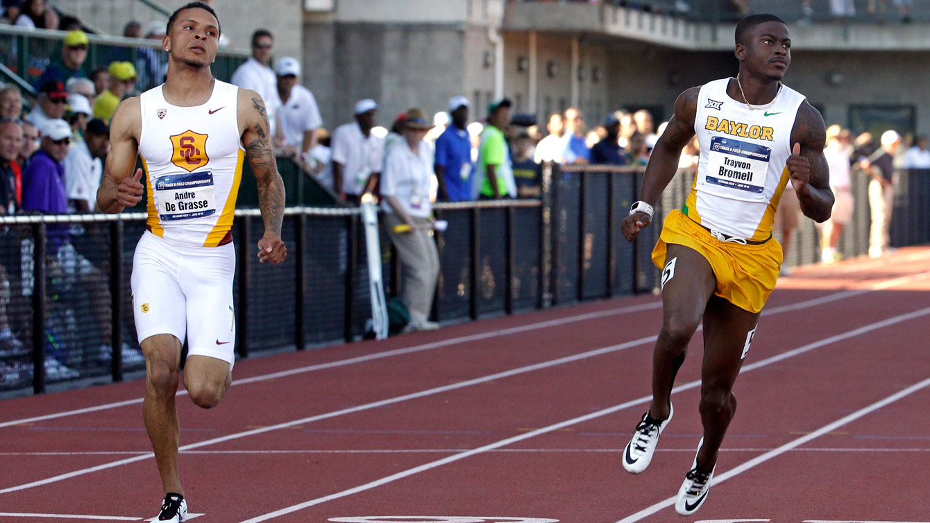 Andre De Grasse (left) and Trayvon Bromell in the NCAA Track and Field Championships semifinals on June 10, 2015.