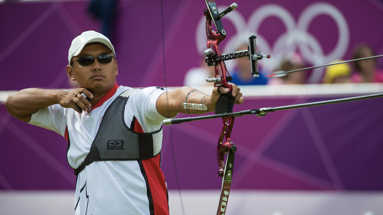 Crispin Duenas releases an arrow during London 2012.