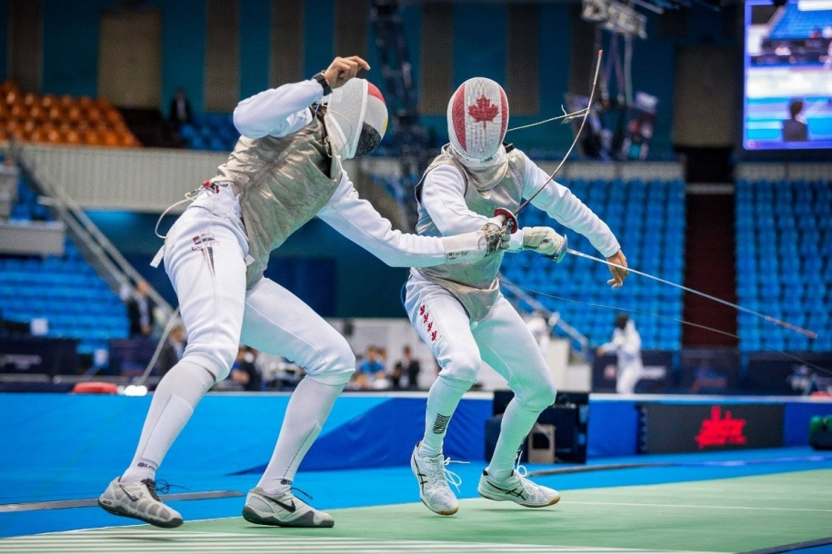 Eli Schenkel competing for Canada in individual foil.