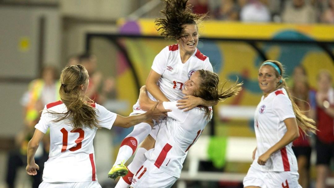 Fleming celebrates with teammates