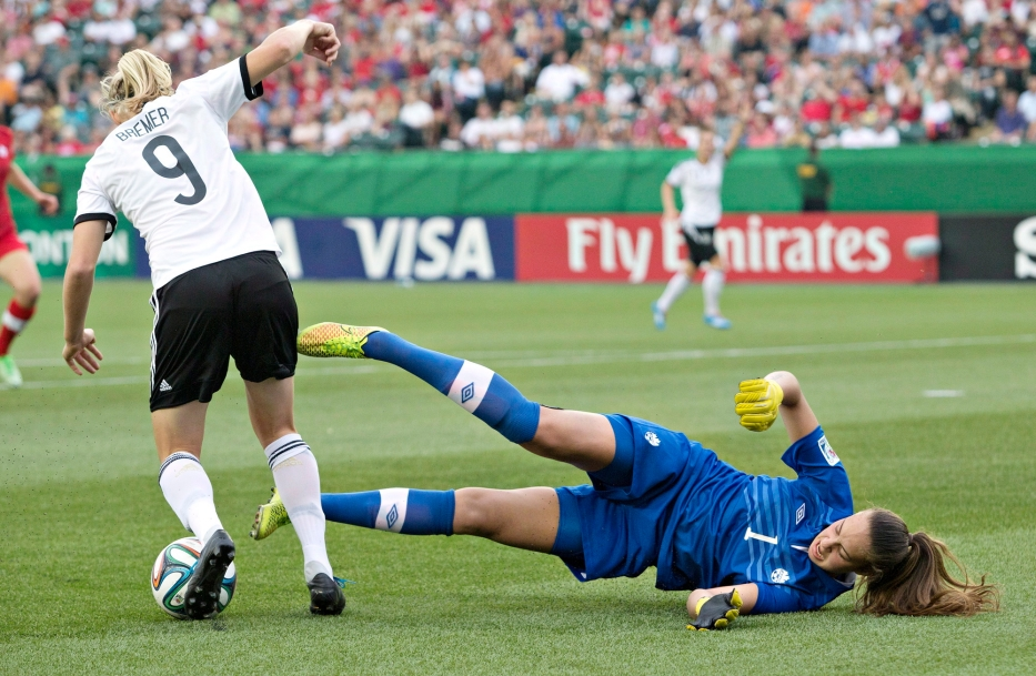 Canada goalkeeper Kailen Sheridan dives in front of Germany's Pauline Bremer during first half action of the FIFA U-20 Women's World Cup quarter-finals