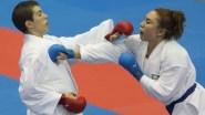 Olivia Grant (left) of Toronto faces Xunashi Caballero of Mexico in karate semi-finals at the 2011 Pan American Games in Guadalajara.