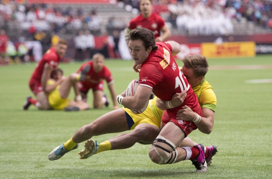 Canada's Pat Kay scores a try