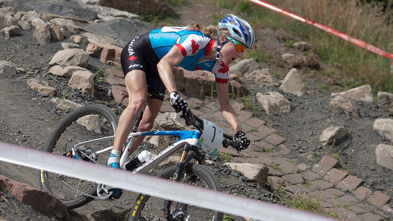 Catharine Pendrel races to gold in the women's cross-country event at Cathkin Braes mountain bike trails at the Commonwealth Games in Glasgow, Scotland, July 29, 2014.