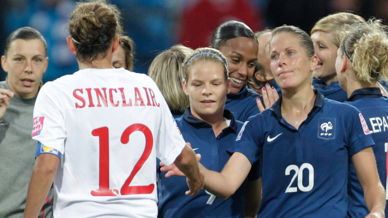 Canada's Christine Sinclair shakes hands with French players after a 4-0 loss to France at the FIFA 2011 Women's World Cup.