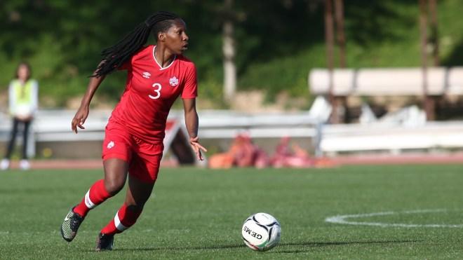 Kadeisha Buchanan with the ball on the pitch
