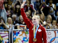 Canada's Ellie Black shows off her gold medal at the women's artistic all around gymnastics competition during the Pan American Games in Toronto on Monday, July 13, 2015. THE CANADIAN PRESS/Nathan Denette