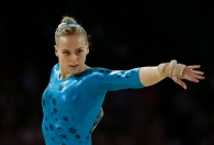 Canada's Ellie Black performs the floor exercise during women's artistic gymnastics all-around competition in the Pan Am Games in Toronto, Monday, July 13, 2015. Black won the gold medal in the event. (AP Photo/Gregory Bull)