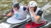 Canada's Jazmyne Denhollander (right) reacts with US Ashley Nee after crossing the finish line in the Women's Kayak (K1) final at the Minden White Water Preserve.