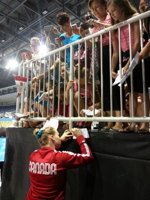 Ellie Black signs autographs after winning the women's artistic all around gymnastics competition during the Pan American Games in Toronto on Monday, July 13, 2015.