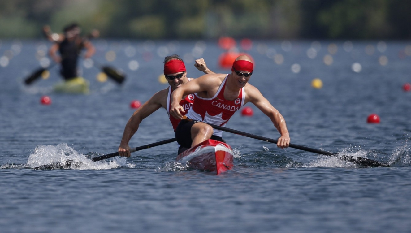 Canada's Benjamin Russell and Gabriel Beauchesne-Sevigny celebrate Gold in the C2 1000M race at the Pan Am Games in Toronto Monday, July 13, 2015.  COC Photo by Michael P. Hall