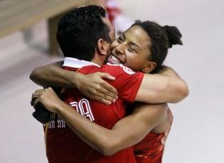 Jennifer Abel hugs coach Arturo Miranda after winning 3-metre gold at TO2015.