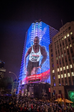 Large wall projections of Olympic legends, such as Donovan Bailey, were on display for the gathered audience at Canada Olympic Excellence Day on July 9, 2015 in Montreal.