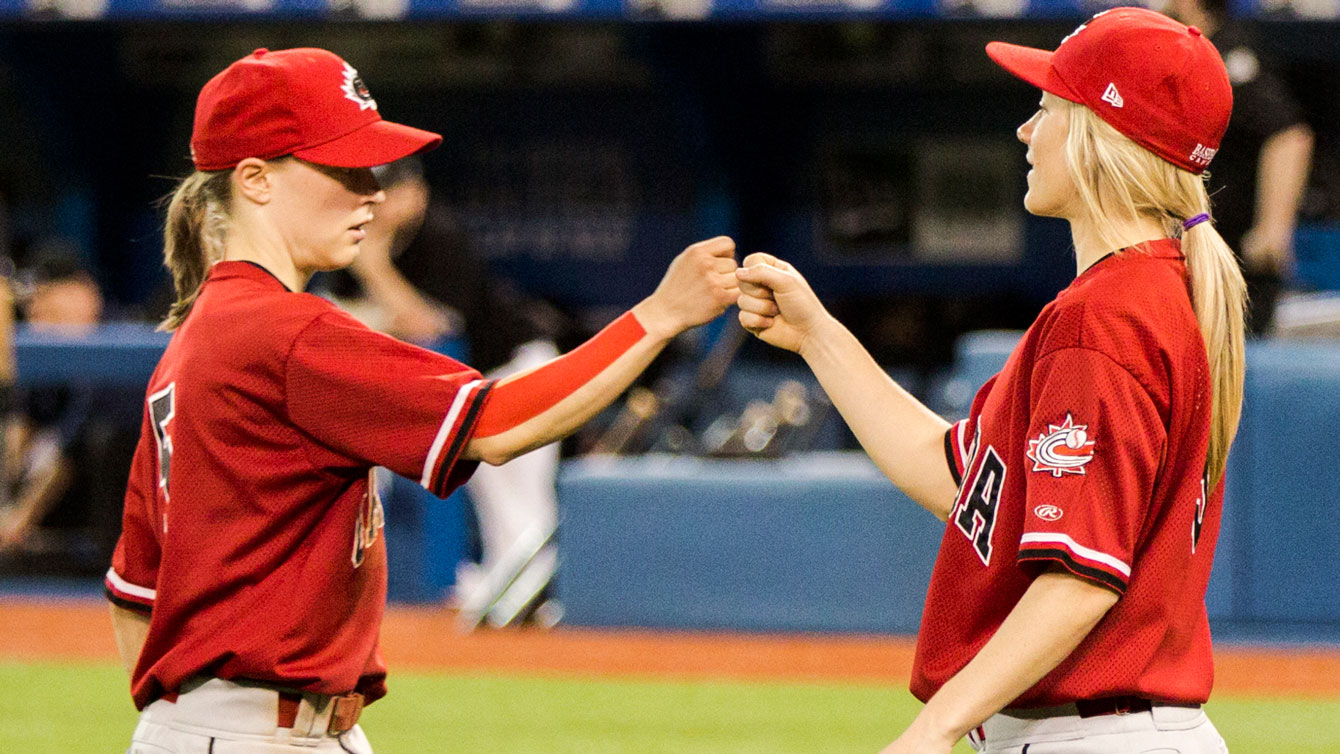 Team Canada members give a fist bump during a match at TO2015