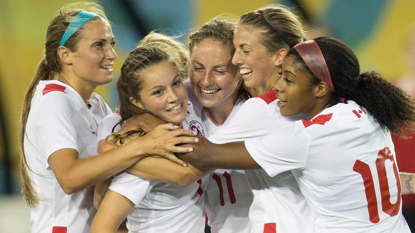 Members of the Canada women's football team celebrate one of Janine Beckie's goals in a 5-2 Pan Am Games win over Ecuador on July 11, 2015.