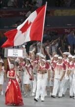 Adam van Koeverden carries the flag in the opening ceremony