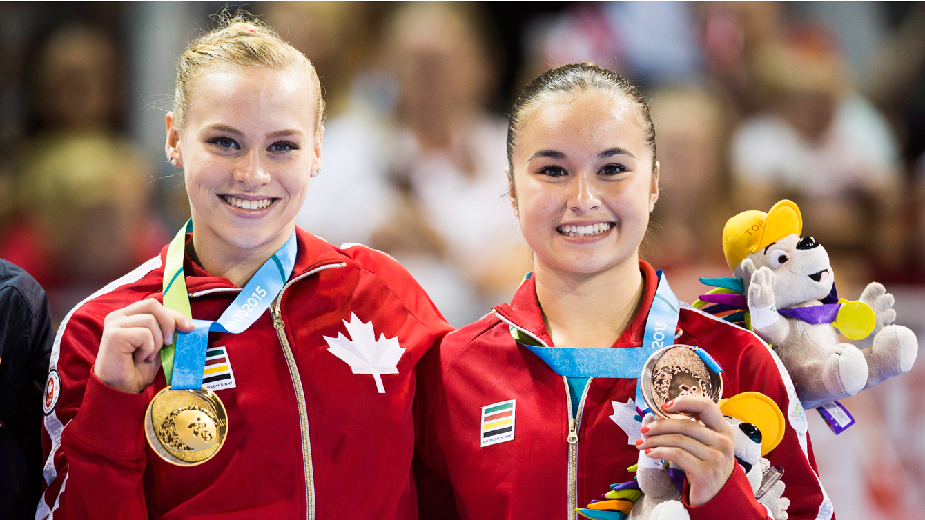 Ellie Black, right, holds her gold medal and Victoria Woo, holding her bronze, following the during the artistic gymnastics balance beam at the Pan Am Games on July 15, 2015. (Photo: Mark Blinch, Canadian Press)