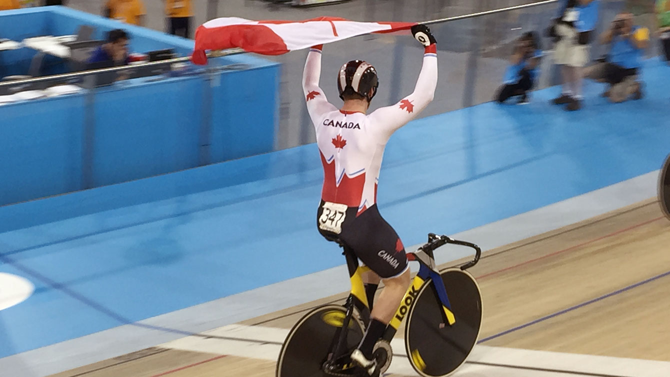 Canadian cyclist celebrates men's sprint track cycling Pan Am Games gold on July 16, 2015.