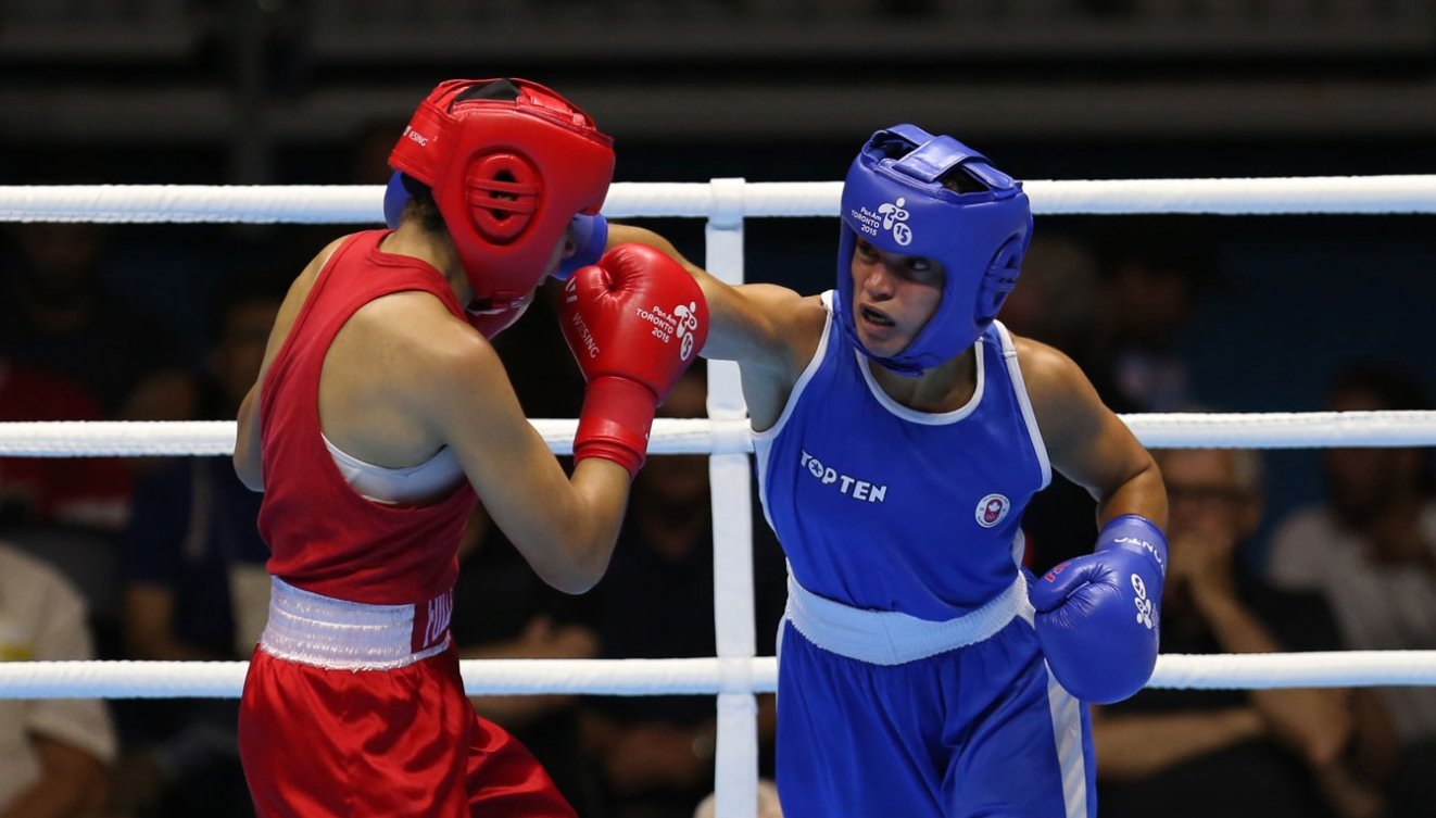 Caroline Veyre won gold in the women's light (57-60kg) division on Day 15.