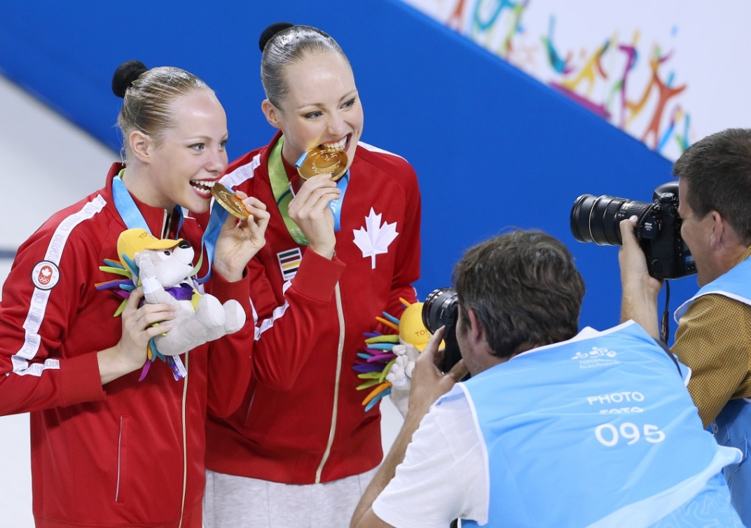 Karine Thomas and Jacqueline Simoneau of Canada compete in the Synchronized Swimming Duet Free Routine and win the Gold Medal. Photo by Vaughn Ridley.