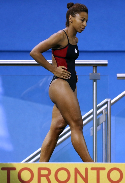 TORONTO, ON - JULY 12:  Jennifer Abel of Canada competes in the Women's 3m Springboard Prelims during the Toronto 2015 Pan Am Games at the CIBC Aquatic Centre on July 12, 2015 in Toronto, Ontario, Canada.  (Photo by Vaughn Ridley/Canada Diving)