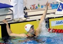 Chantal Van Landeghem celebrates her 100m freestyle victory at the Toronto 2015 Pan American Games.