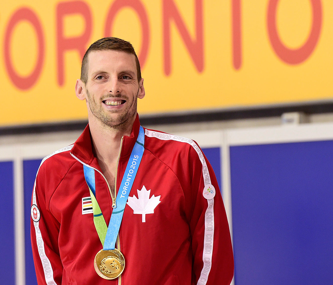 Ryan Cochrane smiles after receiving his Pan Am gold medal in the 400m freestyle, he also won the 1500m freestyle.