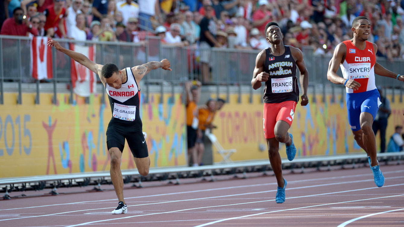 Andre De Grasse leans in to take the 200m Pan Am Games title from Lane 8 in Toronto on July 24, 2015.