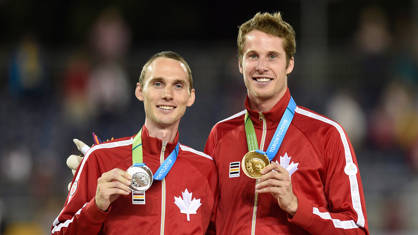 Derek Drouin (right) and  Mike Mason (left) celebrate after the men's high jump final at the 2015 Pan Am Games on  July 25, 2015. (THE CANADIAN PRESS/Frank Gunn)