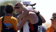 Evan Dunfee (right) and Inaki Gomez embrace after the pair finished 1-2 in Pan Am Games men's race walk on July 19, 2015.