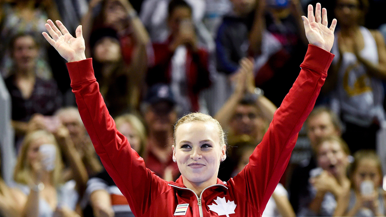 Ellie Black waves to the crowd after winning the women's all-around at the Pan Am Games on July 13, 2015.