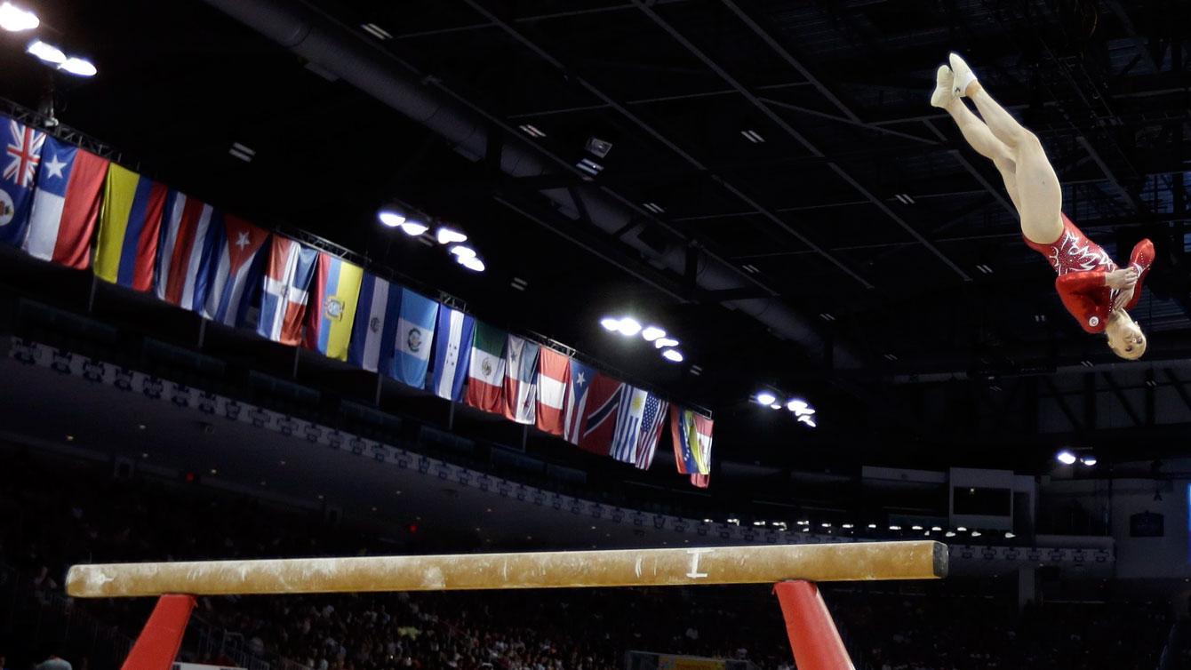 Ellie Black competes on beam at Toronto 2015.