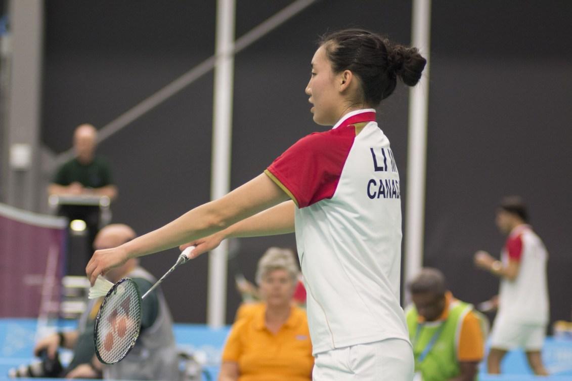 Michelle Li prepares to serve in the doubles matchup against Haramara Gaitan and Cynthia Gonzalez of Mexico.  Jeffrey Sze/COC