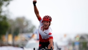 Jasmin Glaesser lets out a massive yell after crossing the line for TO2015 gold int he women's road race on Day 15.