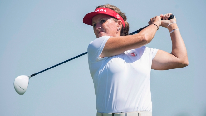 Lori Cane swinging golf club