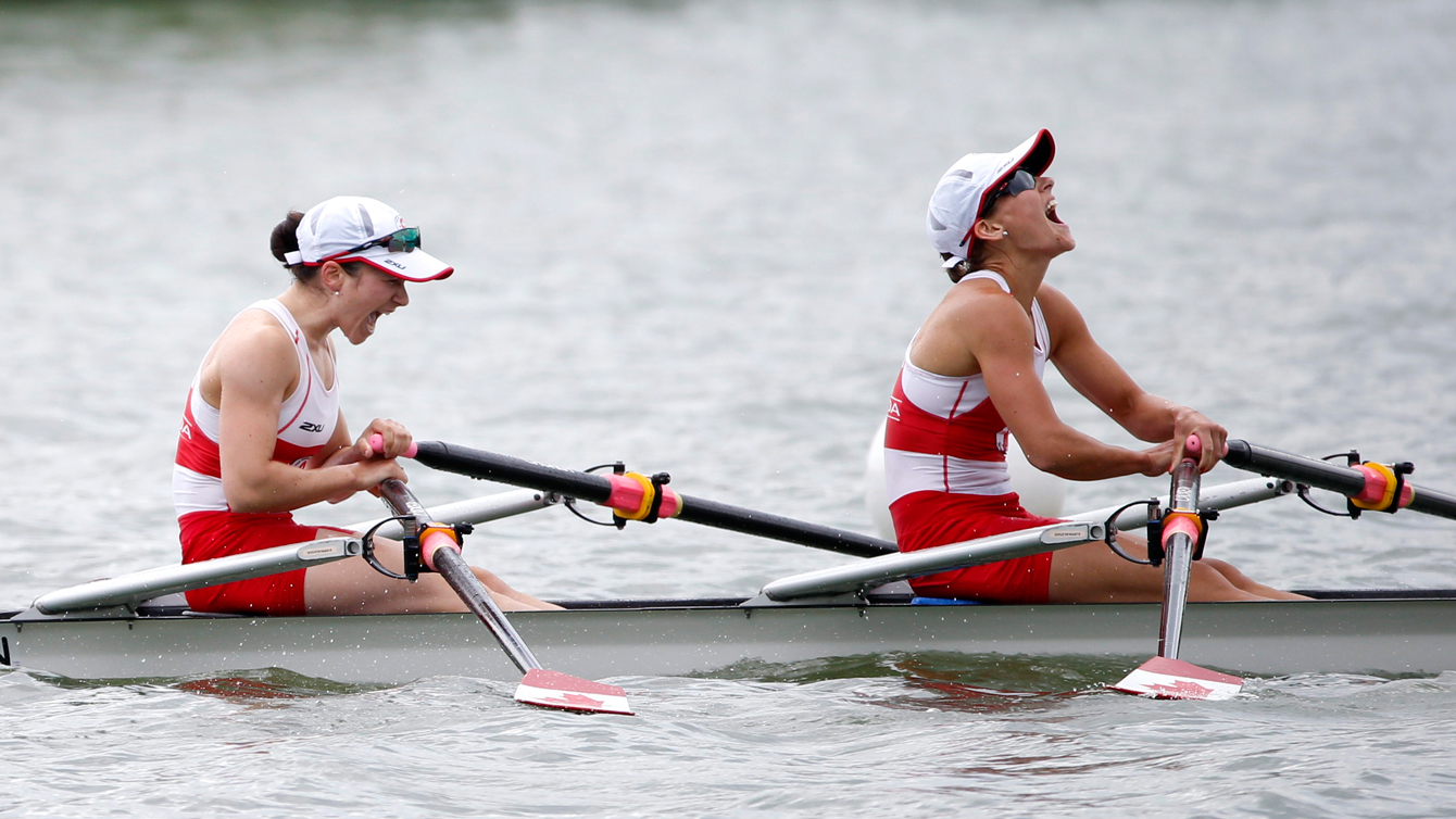 Liz Fenje, left, and Katherine Sauks rejoices after winning the women's lightweight double scull at the Pan Am Games July 14, 2015.