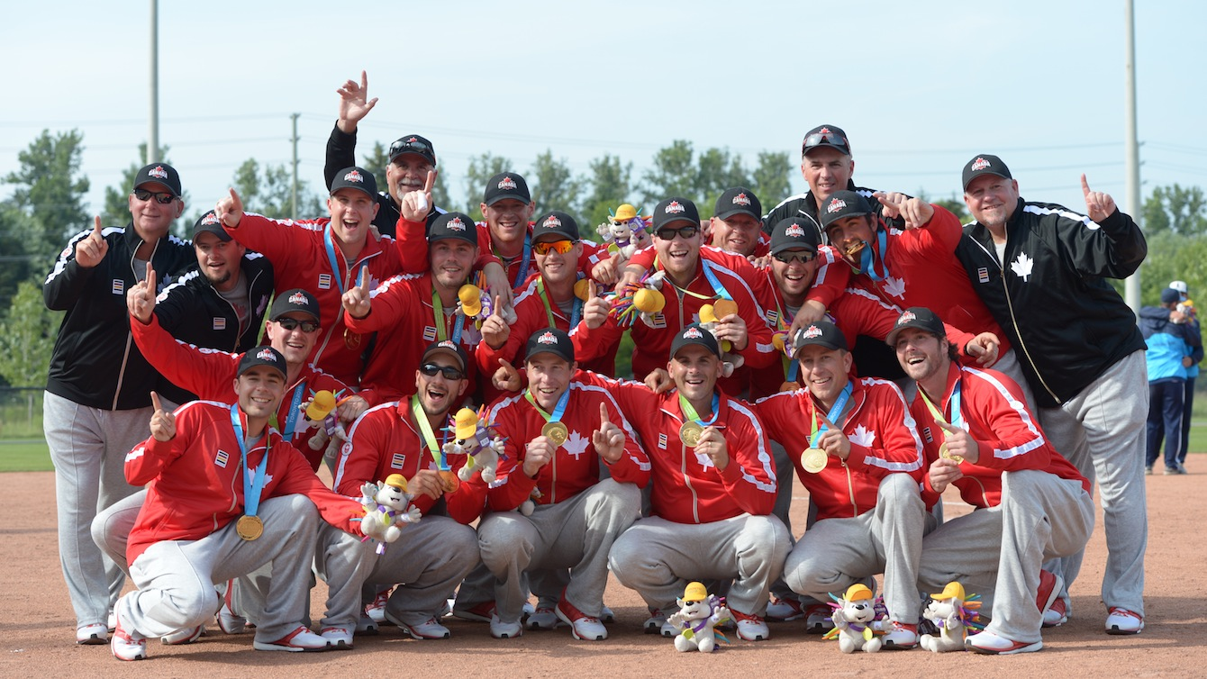 Men's softball team poses with their medals