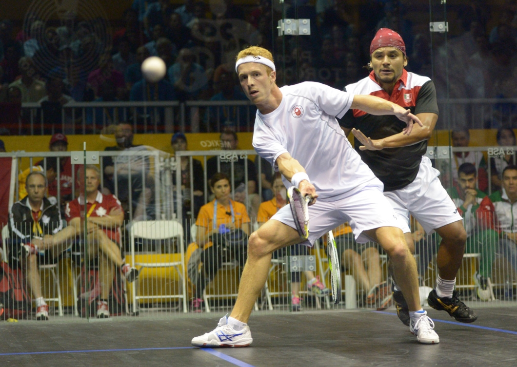 Andrew Schnell hits a shot against Mexican Eric Galvez. (Photo: Winston Chow)