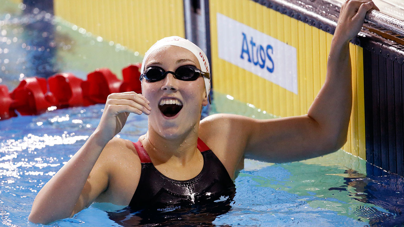 Canada's Emily Overholt is overjoyed after swimming to gold in the women's 400m freestyle at TO2015 Pan Am Games.