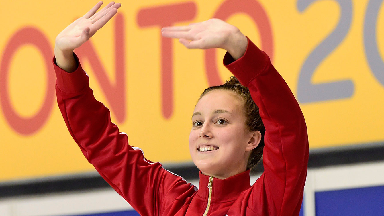 Emily Overholt waves to the crowd after winning Pan Am Games gold on July 17, 2015.