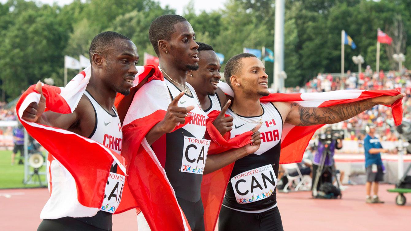Gavin Smellie (left) ran the first leg for Canada in the men's 4x100m final at the Pan Am Games on July 25, 2015.