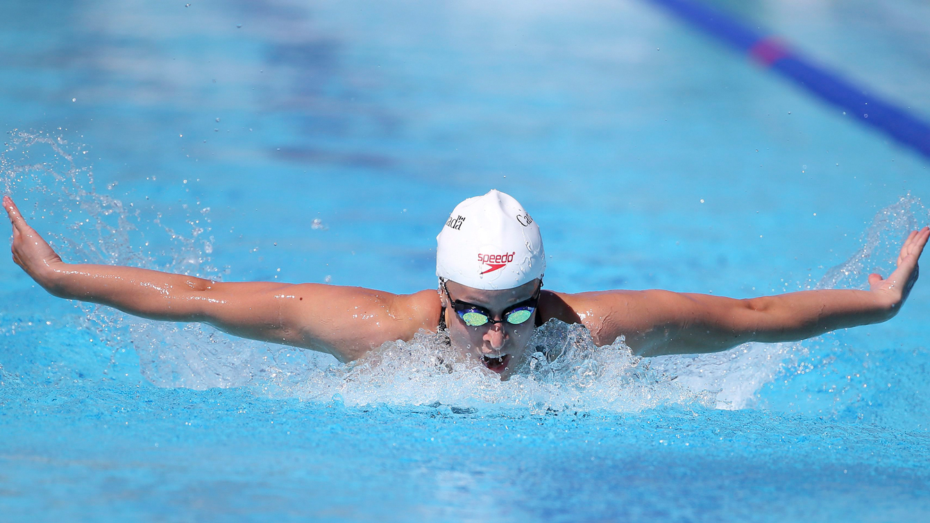 Canada's Katerine Savard swims during her women's 200-meter butterfly