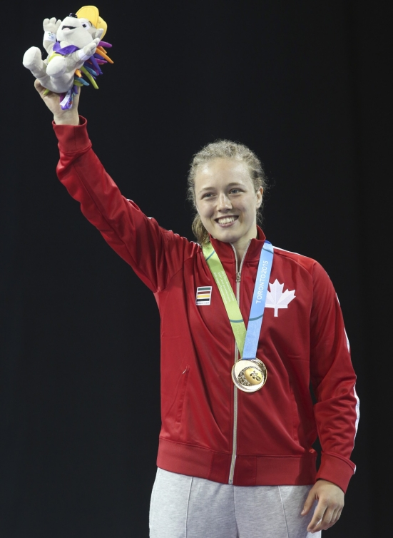 Dorothy Yeats (blue) of Montreal celebrates her gold medal in the freestyle wrestling finals at the PanAmerican Games in Mississauga, Ont., Friday, July 17, 2015. Photo by Mike Ridewood/COC