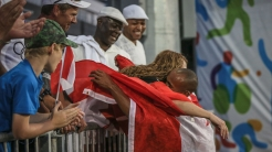 Damian Warner hugs his mother after winning the decathlon at the Pan Am Games in Toronto on July 23, 2015.