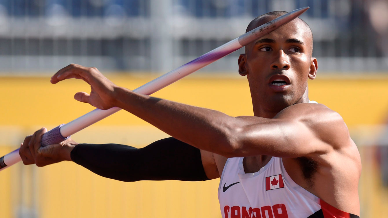 Warner about to throw javelin