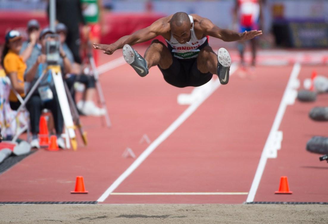 Damian Warner takes flight in the long jump portion of decathlon at Toronto 2015 Pan American Games.