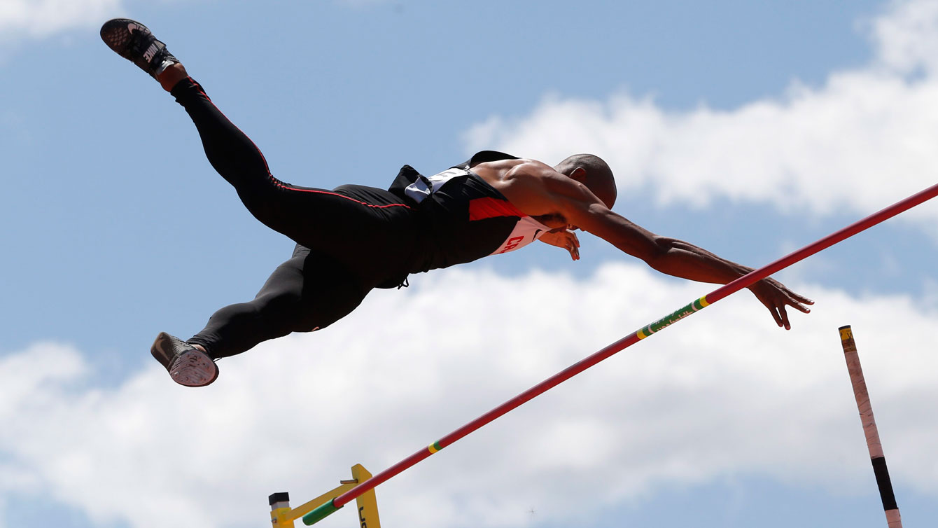 Damian Warner clears the bar in pole vault as part of the decathlon on July 23, 2015 at the Pan Am Games in Toronto.