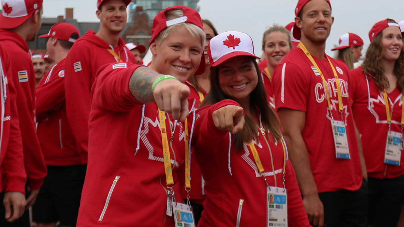 Women's rugby stars Jennifer Kish and Ashley Steacy - who have already qualified for Rio 2016 - at the athletes' village opening for Toronto 2015 Pan American Games.