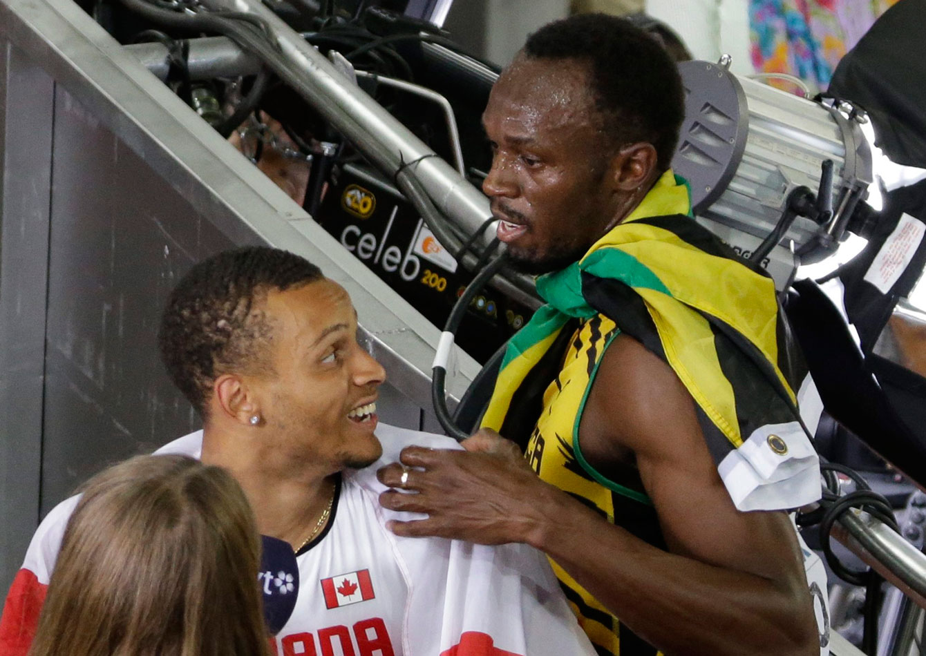 Usain Bolt and Andre De Grasse share a moment after both men won medals in the 100m at the 2015 IAAF World Championships on August 23, 2015 in Beijing, China.